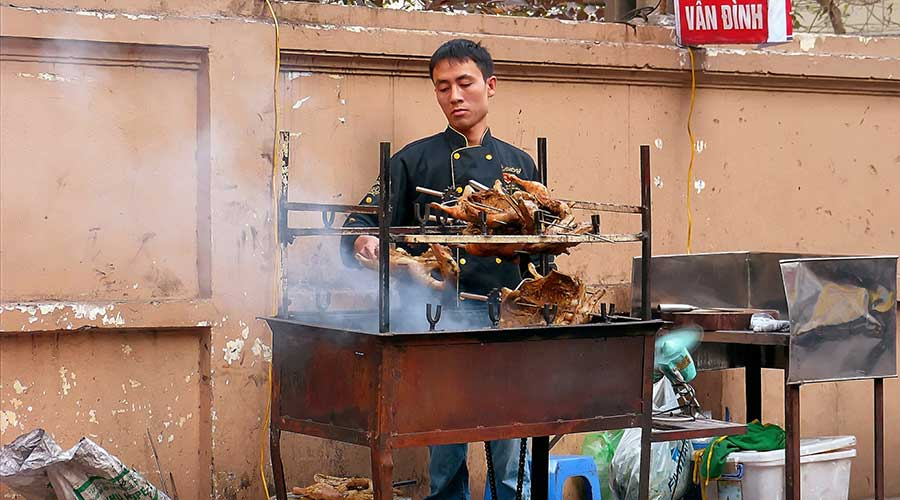 bbq on the street at a food vendor in Hanoi