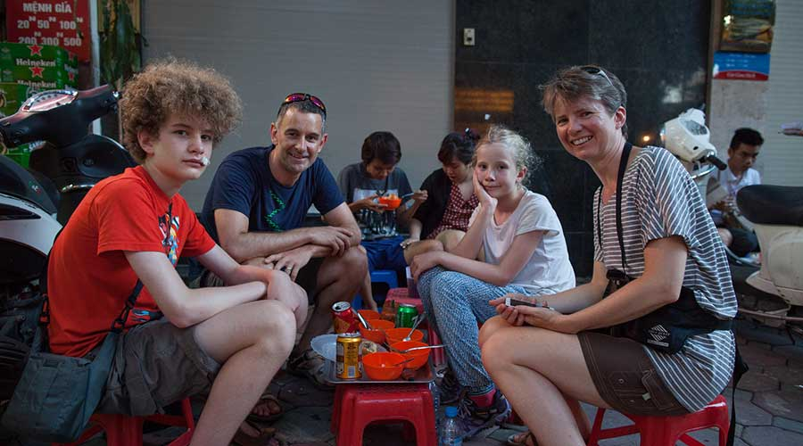 kids at a street food tour in Hanoi