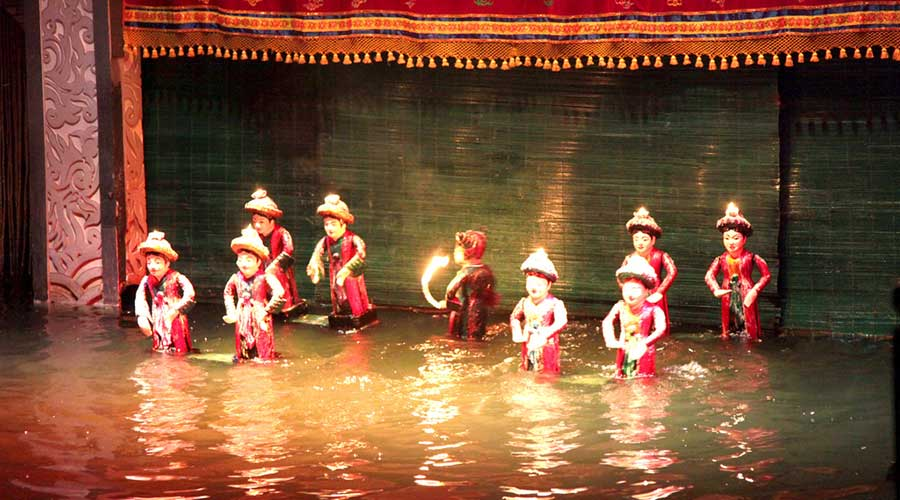 Water puppet show in evening tour
