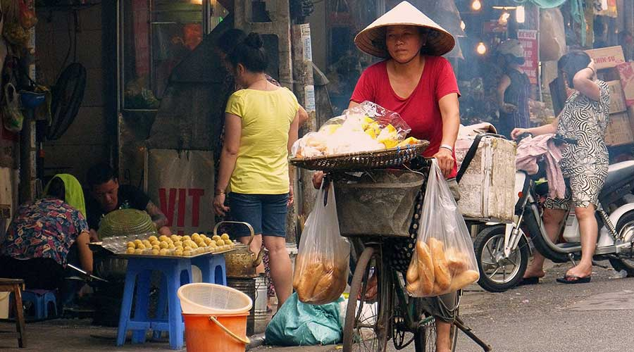 Selling food by bicycle in Hanoi