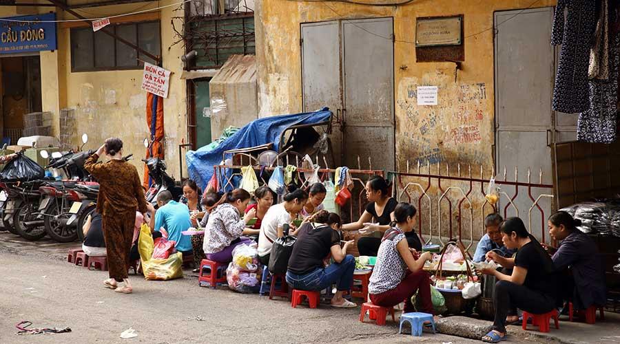 sitting eating street food