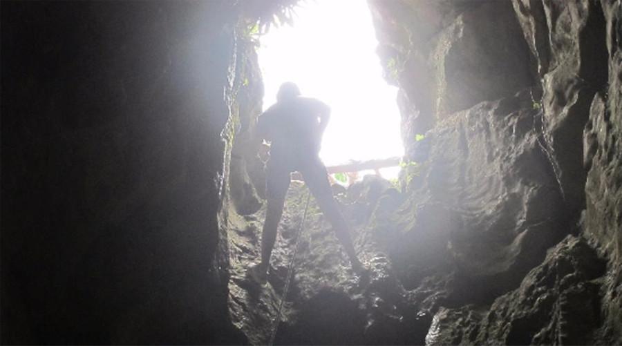 Abseiling in a cave at Da Nang, Vietnam